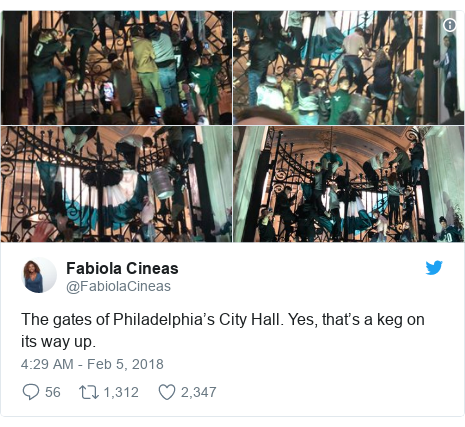 Twitter post by @FabiolaCineas: The gates of Philadelphia's City Hall. Yes, that's a keg on its way up.