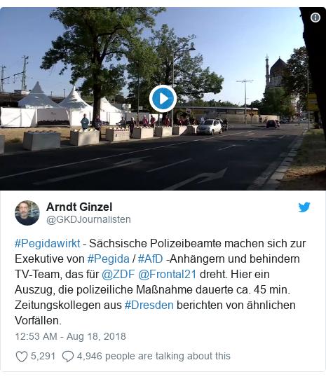 Twitter post by @GKDJournalisten: #Pegidawirkt - Sächsische Polizeibeamte machen sich zur Exekutive von #Pegida / #AfD -Anhängern und behindern TV-Team, das für @ZDF @Frontal21 dreht. Hier ein Auszug, die polizeiliche Maßnahme dauerte ca. 45 min.  Zeitungskollegen aus #Dresden berichten von ähnlichen Vorfällen.