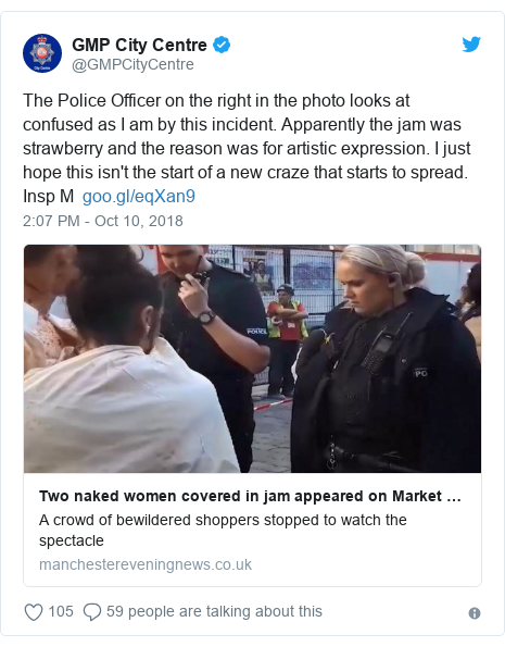 Twitter post by @GMPCityCentre: The Police Officer on the right in the photo looks at confused as I am by this incident. Apparently the jam was strawberry and the reason was for artistic expression. I just hope this isn't the start of a new craze that starts to spread. Insp M