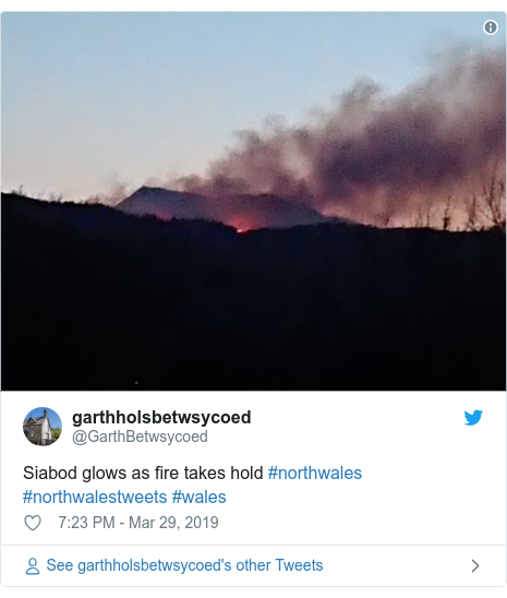 Twitter post by @GarthBetwsycoed: Siabod glows as fire takes hold #northwales #northwalestweets #wales