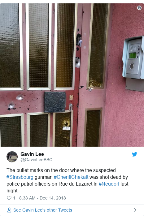 Twitter post by @GavinLeeBBC: The bullet marks on the door where the suspected #Strasbourg gunman #CheriffChekatt was shot dead by police patrol officers on Rue du Lazaret In #Neudorf last night.