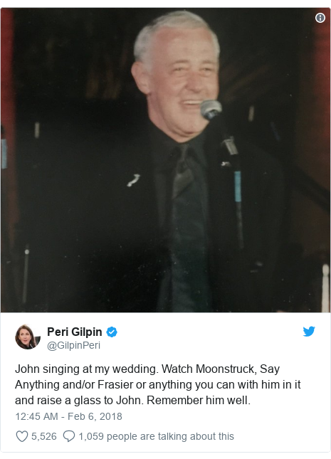 Twitter post by @GilpinPeri: John singing at my wedding. Watch Moonstruck, Say Anything and/or Frasier or anything you can with him in it and raise a glass to John. Remember him well.