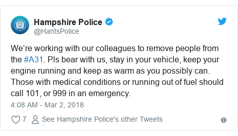 Twitter post by @HantsPolice: We're working with our colleagues to remove people from the #A31. Pls bear with us, stay in your vehicle, keep your engine running and keep as warm as you possibly can. Those with medical conditions or running out of fuel should call 101, or 999 in an emergency.