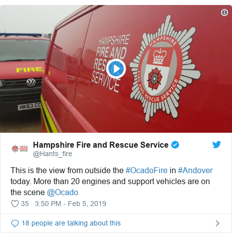 Twitter post by @Hants_fire: This is the view from outside the #OcadoFire in #Andover today. More than 20 engines and support vehicles are on the scene @Ocado