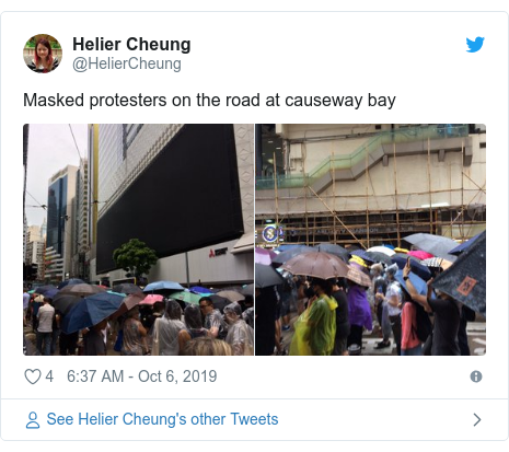 Twitter post by @HelierCheung: Masked protesters on the road at causeway bay
