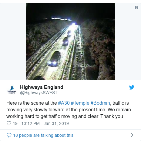 Twitter post by @HighwaysSWEST: Here is the scene at the #A30 #Temple #Bodmin, traffic is moving very slowly forward at the present time. We remain working hard to get traffic moving and clear. Thank you.