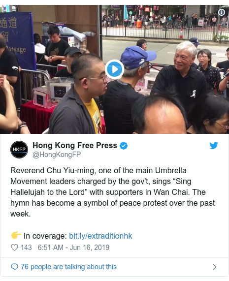 """Twitter post by @HongKongFP: Reverend Chu Yiu-ming, one of the main Umbrella Movement leaders charged by the gov't, sings """"Sing Hallelujah to the Lord"""" with supporters in Wan Chai. The hymn has become a symbol of peace protest over the past week.👉 In coverage"""
