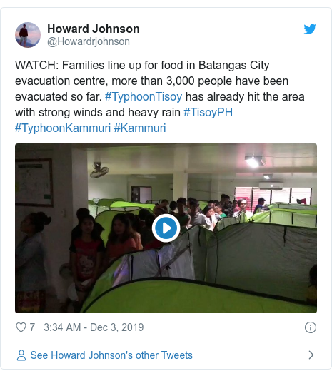 Twitter post by @Howardrjohnson: WATCH  Families line up for food in Batangas City evacuation centre, more than 3,000 people have been evacuated so far. #TyphoonTisoy has already hit the area with strong winds and heavy rain #TisoyPH #TyphoonKammuri #Kammuri