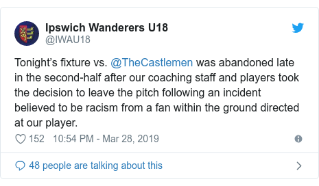 Twitter post by @IWAU18: Tonight's fixture vs. @TheCastlemen was abandoned late in the second-half after our coaching staff and players took the decision to leave the pitch following an incident believed to be racism from a fan within the ground directed at our player.