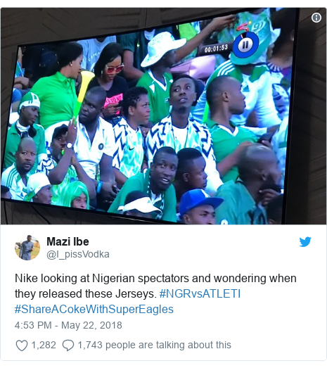 Twitter post by @I_pissVodka: Nike looking at Nigerian spectators and wondering when they released these Jerseys. #NGRvsATLETI #ShareACokeWithSuperEagles