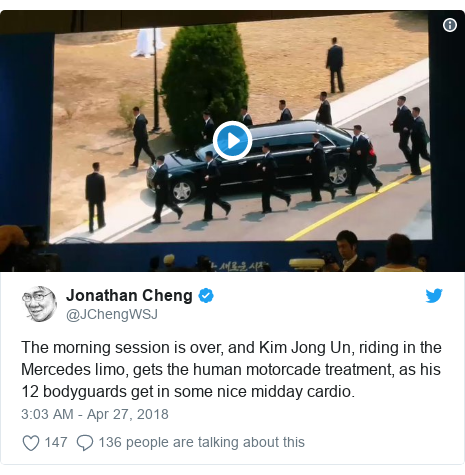 Twitter post by @JChengWSJ: The morning session is over, and Kim Jong Un, riding in the Mercedes limo, gets the human motorcade treatment, as his 12 bodyguards get in some nice midday cardio.
