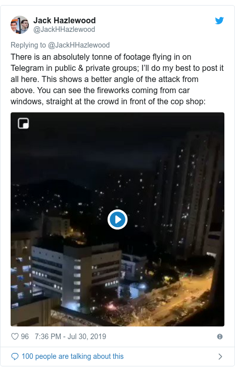 Twitter post by @JackHHazlewood: There is an absolutely tonne of footage flying in on Telegram in public & private groups; I'll do my best to post it all here. This shows a better angle of the attack from above. You can see the fireworks coming from car windows, straight at the crowd in front of the cop shop