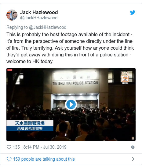 Twitter post by @JackHHazlewood: This is probably the best footage available of the incident - it's from the perspective of someone directly under the line of fire. Truly terrifying. Ask yourself how anyone could think they'd get away with doing this in front of a police station - welcome to HK today.