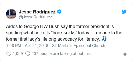 """Twitter post by @JesseRodriguez: Aides to George HW Bush say the former president is sporting what he calls """"book socks"""" today — an ode to the former first lady's lifelong advocacy for literacy. 🧦"""
