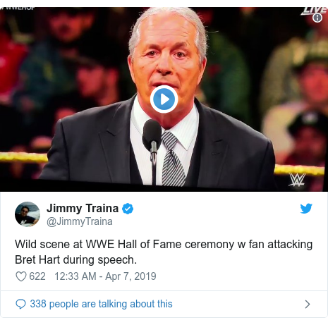 Twitter post by @JimmyTraina: Wild scene at WWE Hall of Fame ceremony w fan attacking Bret Hart during speech.
