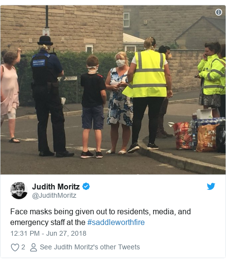 Twitter post by @JudithMoritz: Face masks being given out to residents, media, and emergency staff at the #saddleworthfire