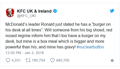"""Twitter post by @KFC_UKI: McDonald's leader Ronald just stated he has a """"burger on his desk at all times"""". Will someone from his big shoed, red nosed regime inform him that I too have a burger on my desk, but mine is a box meal which is bigger and more powerful than his, and mine has gravy! #nuclearbutton"""