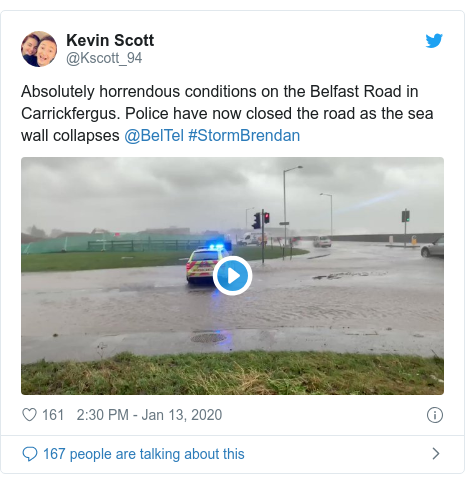 Twitter post by @Kscott_94: Absolutely horrendous conditions on the Belfast Road in Carrickfergus. Police have now closed the road as the sea wall collapses @BelTel #StormBrendan