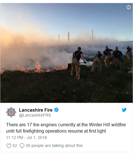 Twitter post by @LancashireFRS: There are 17 fire engines currently at the Winter Hill wildfire until full firefighting operations resume at first light