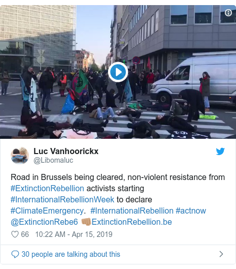 Twitter post by @Libomaluc: Road in Brussels being cleared, non-violent resistance from #ExtinctionRebellion activists starting #InternationalRebellionWeek to declare #ClimateEmergency. #InternationalRebellion #actnow @ExtinctionRebe6 ????????
