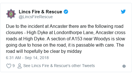 Twitter post by @LincsFireRescue: Due to the incident at Ancaster there are the following road closures - High Dyke at Londonthorpe Lane, Ancaster cross roads at High Dyke. A section of A153 near Woodys is slow going due to hose on the road, it is passable with care. The road will hopefully be clear by midday