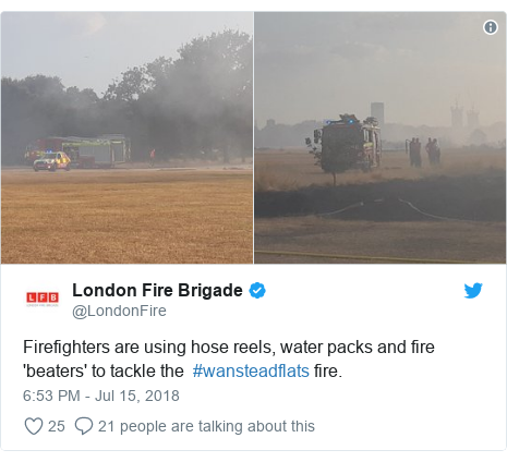 Twitter post by @LondonFire: Firefighters are using hose reels, water packs and fire 'beaters' to tackle the  #wansteadflats fire.