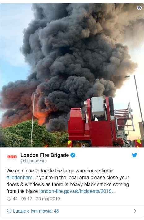 Twitter post by @LondonFire: We continue to tackle the large warehouse fire in #Tottenham. If you're in the local area please close your doors & windows as there is heavy black smoke coming from the blaze