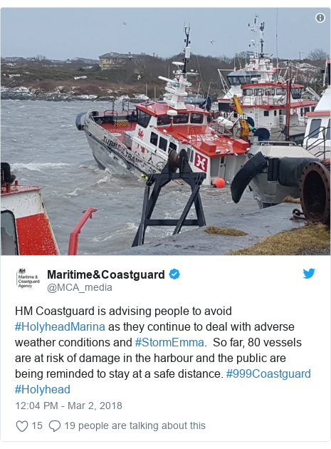 Twitter post by @MCA_media: HM Coastguard is advising people to avoid #HolyheadMarina as they continue to deal with adverse weather conditions and #StormEmma.  So far, 80 vessels are at risk of damage in the harbour and the public are being reminded to stay at a safe distance. #999Coastguard #Holyhead