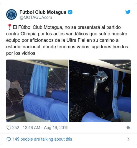 Twitter post by @MOTAGUAcom: 📍El Fútbol Club Motagua, no se presentará al partido contra Olimpia por los actos vandálicos que sufrió nuestro equipo por aficionados de la Ultra Fiel en su camino al estadio nacional, donde tenemos varios jugadores heridos por los vidrios.