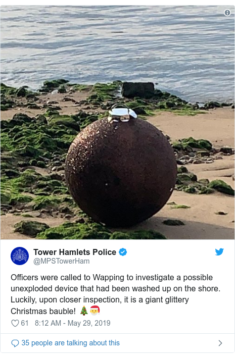 Twitter post by @MPSTowerHam: Officers were called to Wapping to investigate a possible unexploded device that had been washed up on the shore. Luckily, upon closer inspection, it is a giant glittery Christmas bauble! 🎄🎅