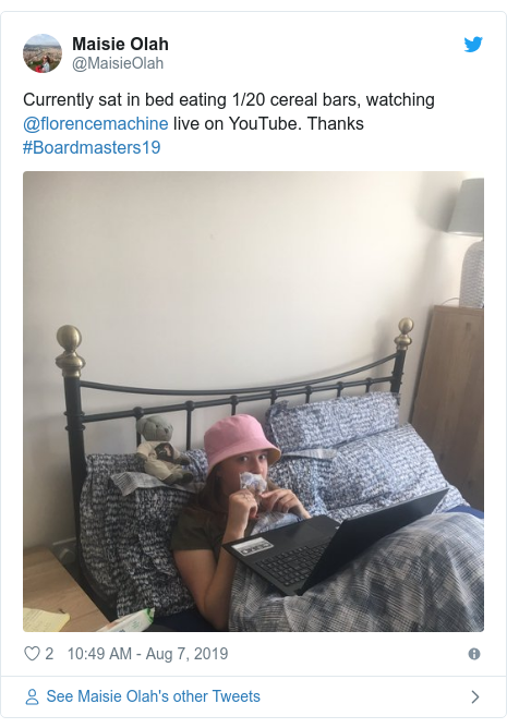Twitter post by @MaisieOlah: Currently sat in bed eating 1/20 cereal bars, watching @florencemachine live on YouTube. Thanks #Boardmasters19