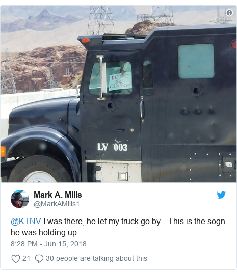 Twitter post by @MarkAMills1: @KTNV I was there, he let my truck go by... This is the sogn he was holding up.