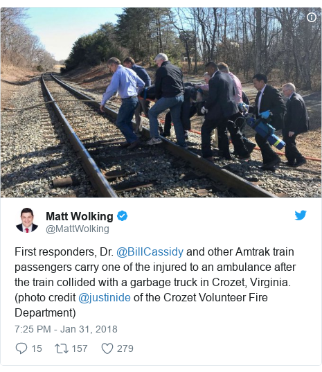 Twitter post by @MattWolking: First responders, Dr. @BillCassidy and other Amtrak train passengers carry one of the injured to an ambulance after the train collided with a garbage truck in Crozet, Virginia. (photo credit @justinide of the Crozet Volunteer Fire Department)