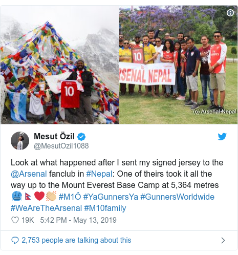 Twitter post by @MesutOzil1088: Look at what happened after I sent my signed jersey to the @Arsenal fanclub in #Nepal  One of theirs took it all the way up to the Mount Everest Base Camp at 5,364 metres 🥶🇳🇵❤👏🏼 #M1Ö #YaGunnersYa #GunnersWorldwide #WeAreTheArsenal #M10family