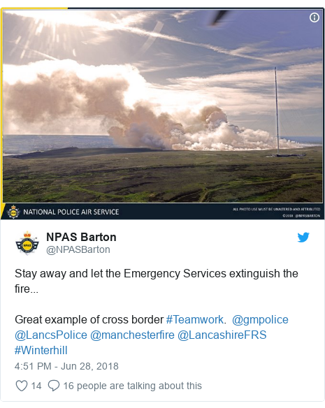 Twitter post by @NPASBarton: Stay away and let the Emergency Services extinguish the fire...  Great example of cross border #Teamwork.  @gmpolice @LancsPolice @manchesterfire @LancashireFRS #Winterhill