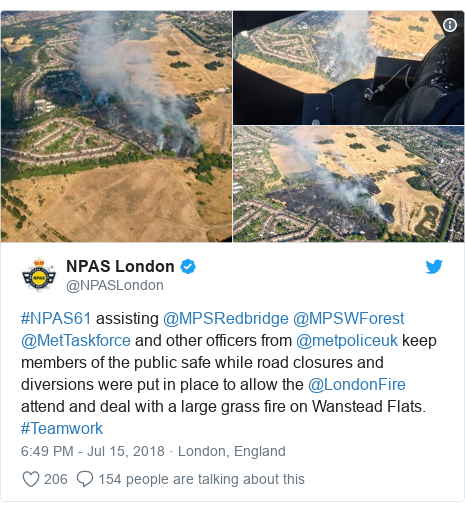Twitter post by @NPASLondon: #NPAS61 assisting @MPSRedbridge @MPSWForest @MetTaskforce and other officers from @metpoliceuk keep members of the public safe while road closures and diversions were put in place to allow the @LondonFire attend and deal with a large grass fire on Wanstead Flats. #Teamwork