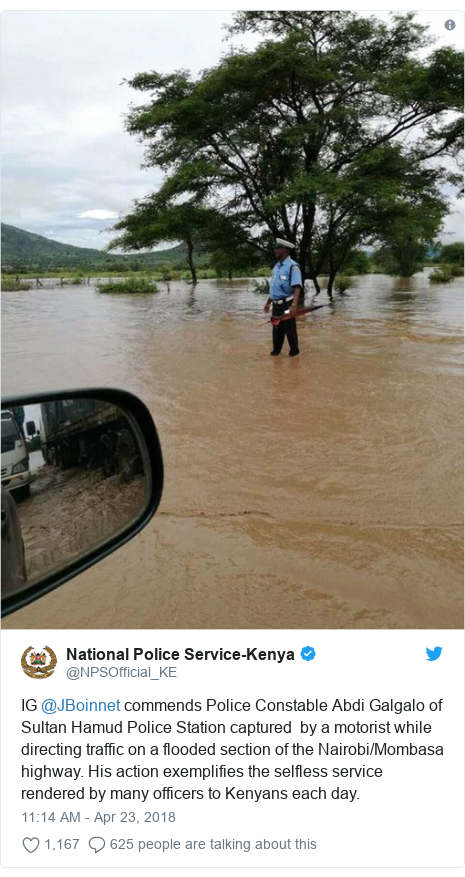 Twitter post by @NPSOfficial_KE: IG @JBoinnet commends Police Constable Abdi Galgalo of Sultan Hamud Police Station captured  by a motorist while directing traffic on a flooded section of the Nairobi/Mombasa highway. His action exemplifies the selfless service rendered by many officers to Kenyans each day.