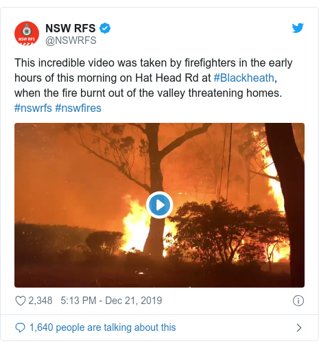 Twitter post by @NSWRFS: This incredible video was taken by firefighters in the early hours of this morning on Hat Head Rd at #Blackheath, when the fire burnt out of the valley threatening homes. #nswrfs #nswfires