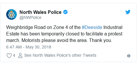Twitter post by @NWPolice: Weighbridge Road on Zone 4 of the #Deeside Industrial Estate has been temporarily closed to facilitate a protest march. Motorists please avoid the area. Thank you.