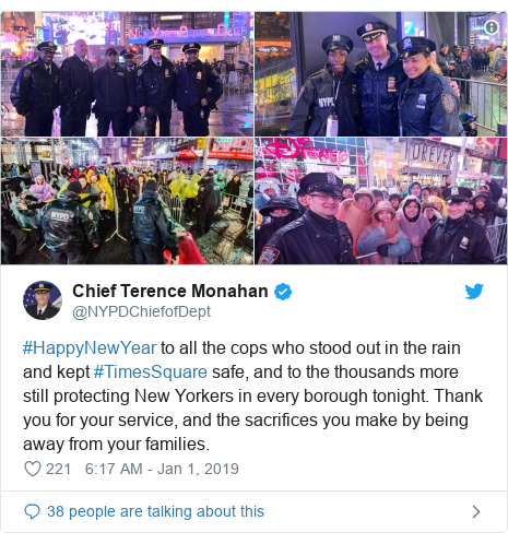 Twitter post by @NYPDChiefofDept: #HappyNewYear to all the cops who stood out in the rain and kept #TimesSquare safe, and to the thousands more still protecting New Yorkers in every borough tonight. Thank you for your service, and the sacrifices you make by being away from your families.