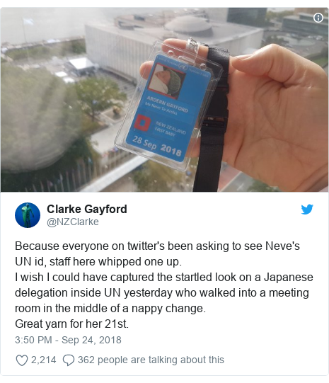 Twitter post by @NZClarke: Because everyone on twitter's been asking to see Neve's UN id, staff here whipped one up. I wish I could have captured the startled look on a Japanese delegation inside UN yesterday who walked into a meeting room in the middle of a nappy change.Great yarn for her 21st.