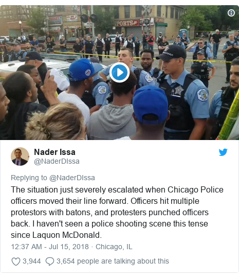 Twitter post by @NaderDIssa: The situation just severely escalated when Chicago Police officers moved their line forward. Officers hit multiple protestors with batons, and protesters punched officers back. I haven't seen a police shooting scene this tense since Laquon McDonald.