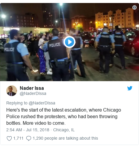 Twitter post by @NaderDIssa: Here's the start of the latest escalation, where Chicago Police rushed the protesters, who had been throwing bottles. More video to come.