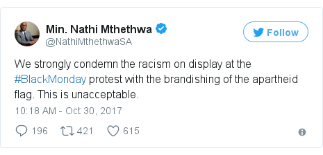 Twitter post by @NathiMthethwaSA: We strongly condemn the racism on display at the #BlackMonday protest with the brandishing of the apartheid flag. This is unacceptable.
