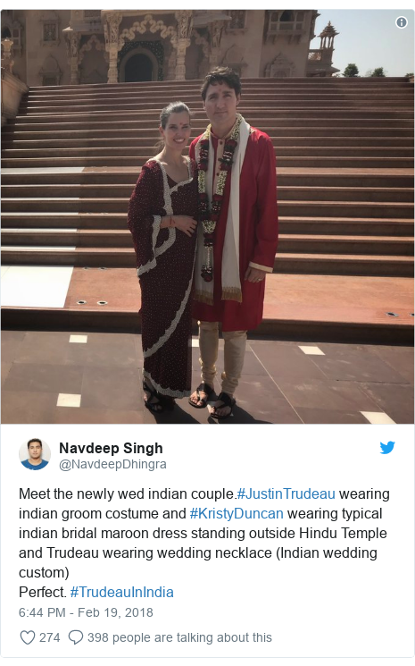 Twitter post by @NavdeepDhingra: Meet the newly wed indian couple.#JustinTrudeau wearing indian groom costume and #KristyDuncan wearing typical indian bridal maroon dress standing outside Hindu Temple and Trudeau wearing wedding necklace (Indian wedding custom)Perfect. #TrudeauInIndia