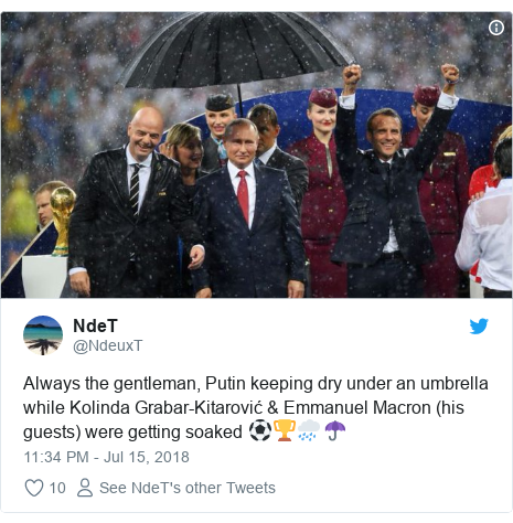Twitter post by @NdeuxT: Always the gentleman, Putin keeping dry under an umbrella while Kolinda Grabar-Kitarović & Emmanuel Macron (his guests) were getting soaked ⚽️🏆🌧☂️