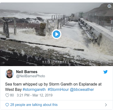 Twitter post by @NeilBarnesPhoto: Sea foam whipped up by Storm Gareth on Esplanade at West Bay #stormgareth  #StormHour @bbcweather