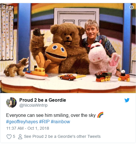 Twitter post by @NicolaWintrip: Everyone can see him smiling, over the sky 🌈#geoffreyhayes #RIP #rainbow