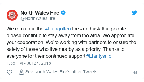 Twitter post by @NorthWalesFire: We remain at the #Llangollen fire - and ask that people please continue to stay away from the area. We appreciate your cooperation. We're working with partners to ensure the safety of those who live nearby as a priority. Thanks to everyone for their continued support #Llantysilio