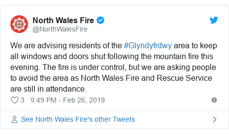 Twitter post by @NorthWalesFire: We are advising residents of the #Glyndyfrdwy area to keep all windows and doors shut following the mountain fire this evening. The fire is under control, but we are asking people to avoid the area as North Wales Fire and Rescue Service are still in attendance.